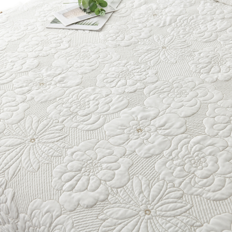 white embroidered quilt set